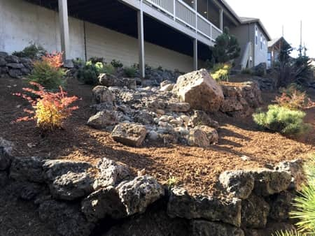 Natural rock landscaping in backyard