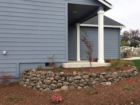 Natural rock landscaping in front yard