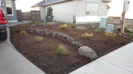 Natural rock and custom paver patio