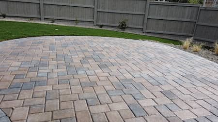 Paver walk way with fire place in backyard in Medford