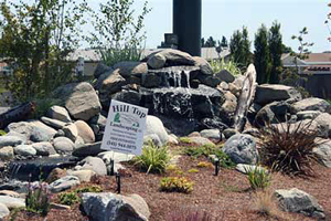 large fountain and stream in rock