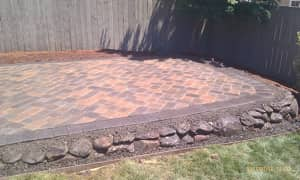 raised patio with red brick