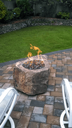 custom fire pit and brick patio