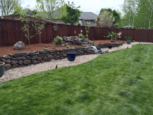 rennovation with retaining wall and fountain