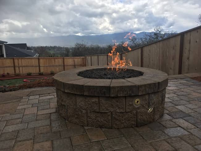 Custom fire pit, natural gas on paver patio