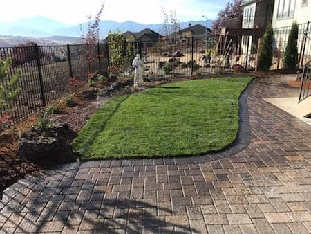 Patio with grass and custom paver patio