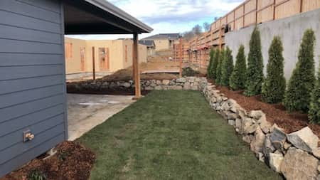 Natural Rock Retaining Wall In Back Yard