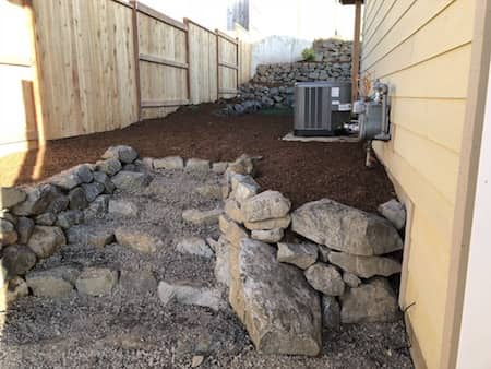 Natural Rock Stirs On Side Of Home